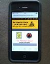 Mobile phone showing our mobile friendly web site on it